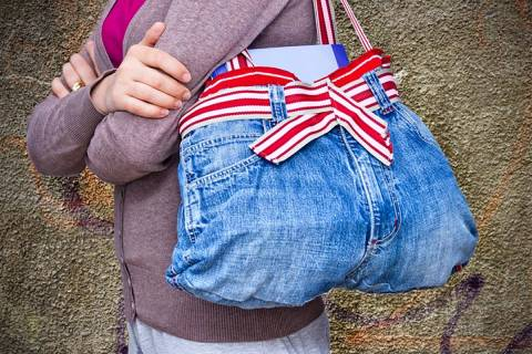 """An old pair of woman's jeans converted into a handbag is an example of """"upcycling."""" (Getty Images)"""
