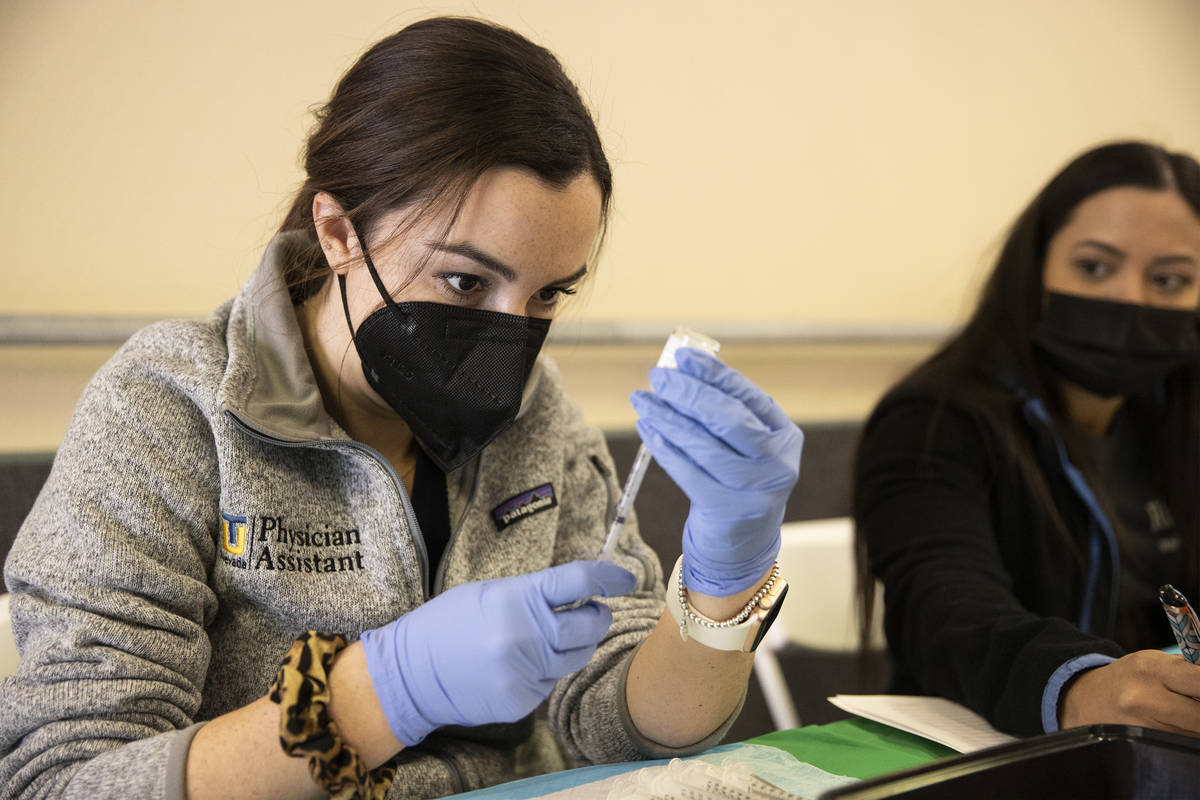 Touro University Nevada physician assistant student Madison Ginis extracts COVID-19 vaccines fr ...