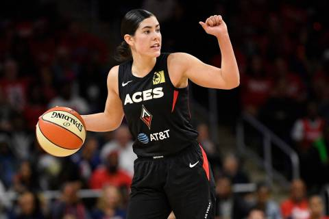 Las Vegas Aces guard Kelsey Plum dribbles the ball against the Washington Mystics during the se ...