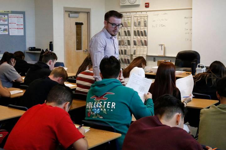 Spencer Skees, Desert Oasis High School math teacher, supervises his student's test in 2018 in ...