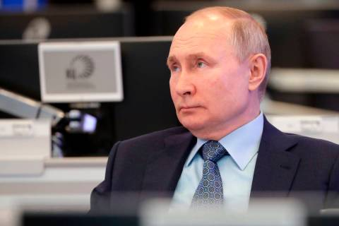 Russian President Vladimir Putin visits the Coordination Center of the Russian Government in Mo ...
