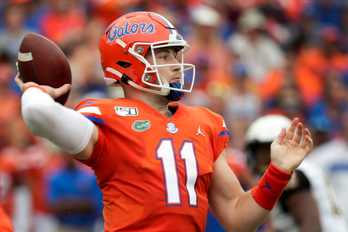Florida quarterback Kyle Trask throws a pass against Towson during the first half of an NCAA co ...