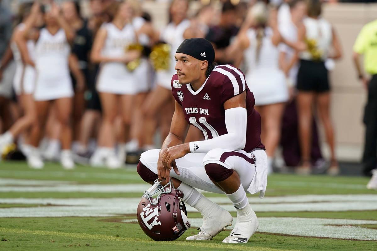 Texas A&M quarterback Kellen Mond (11) watches warmups before the start of a NCAA college f ...