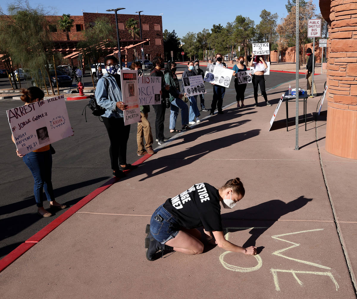 Jazz Appin of Las Vegas writes on the sidewalk outside the main entrance to the Clark County Go ...
