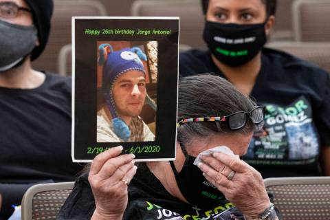 Carol Luke, holding a photograph of Jorge Gomez, weeps as she attends a public fact-finding rev ...