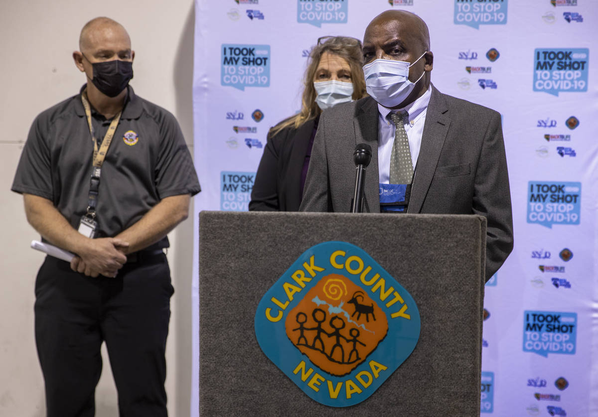 (From right) Dr. Fermin Leguen, Commissioner Marilyn Kirkpatrick and Chief Greg Cassell brief t ...
