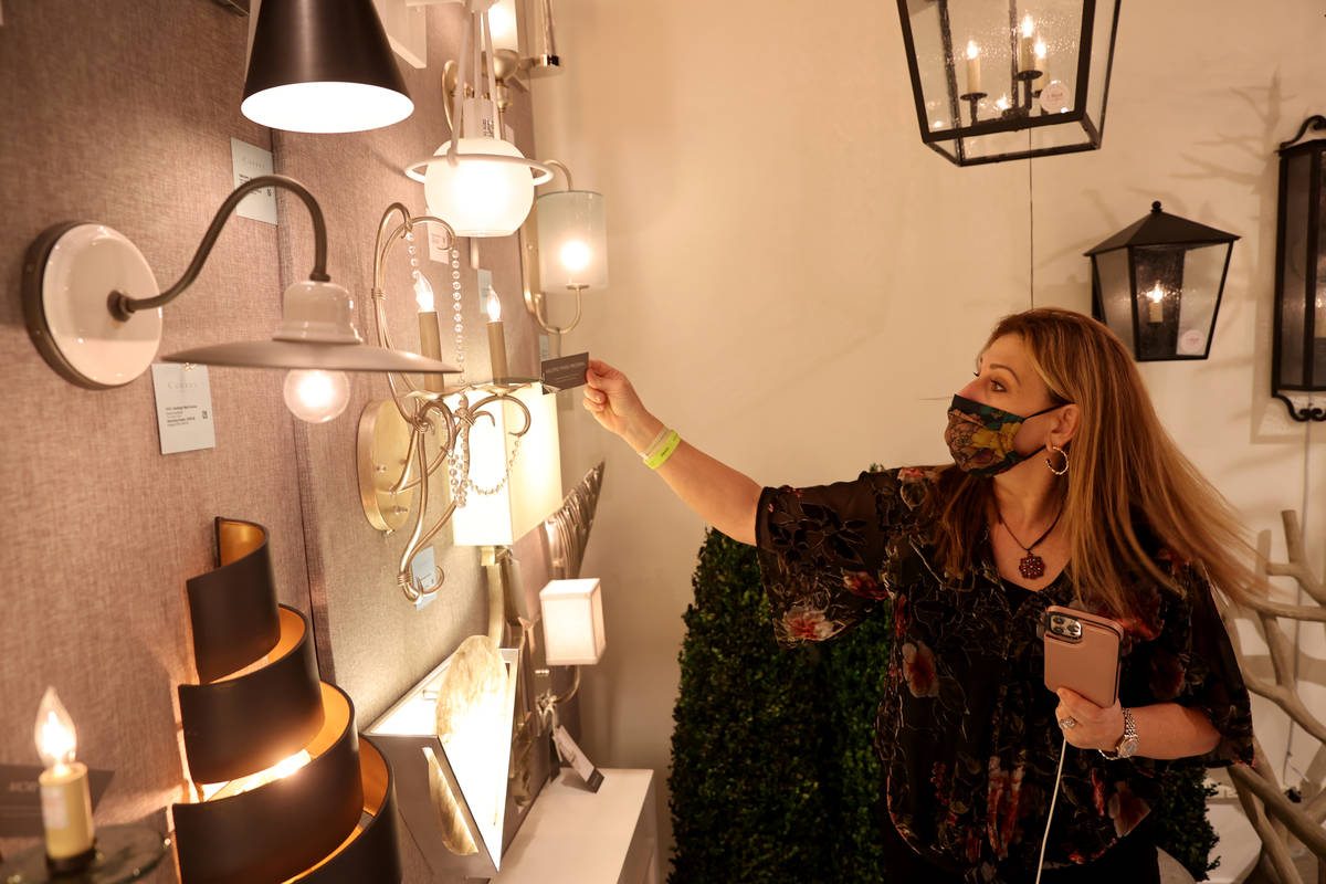 Tracy Stanton of Scottsdale, Ariz. checks out lighting on the final day of the Las Vegas Market ...