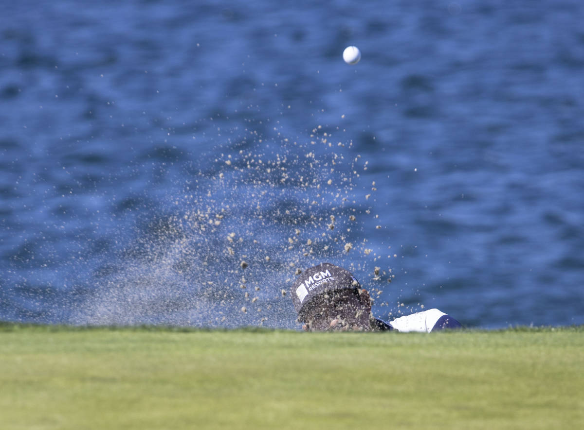 Alex Kang of Las Vegas hits out of a bunker on the fourth hole during the first round of the M ...