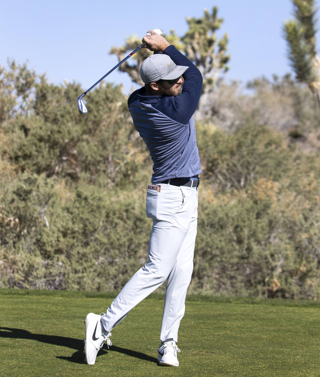 Michael Schoolcraft of Denver, Colo., watches his drive during the first round of the MGM Champ ...