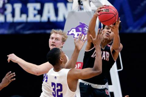 Lamar center David Muoka, right, pulls in a rebound over Abilene Christian center Kolton Kohl ( ...