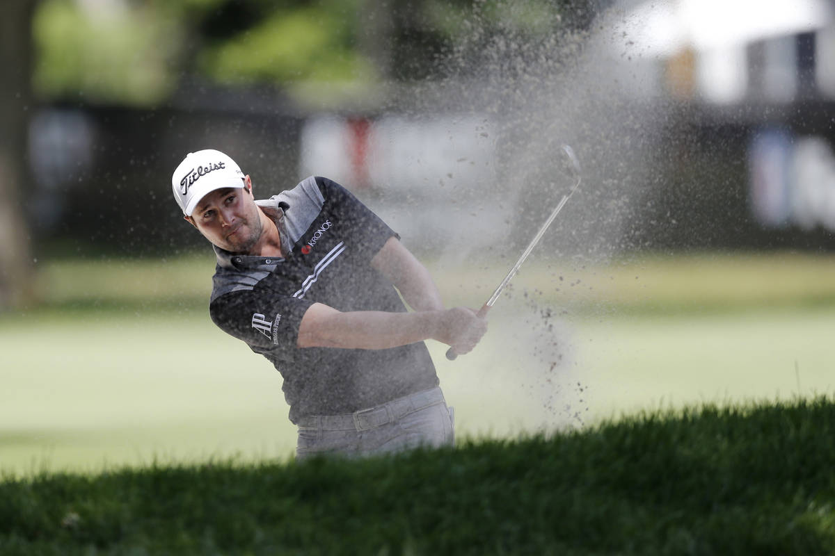 Peter Uihlein hits from the sand on the eighth hole during the second round of the Rocket Mortg ...