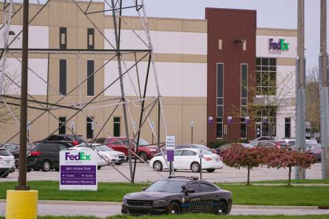 A sheriff's car blocks the entrance to the FedEx facility in Indianapolis, Saturday, April 17, ...