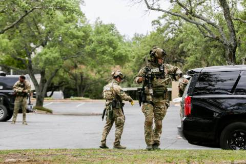 Austin police, SWAT and medical personnel respond to an active shooter situation located Great ...