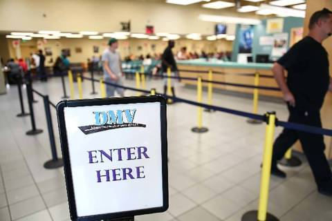 People walk through the line at the DMV office at 2701 E. Sahara Ave. in Las Vegas. (Las Vegas ...