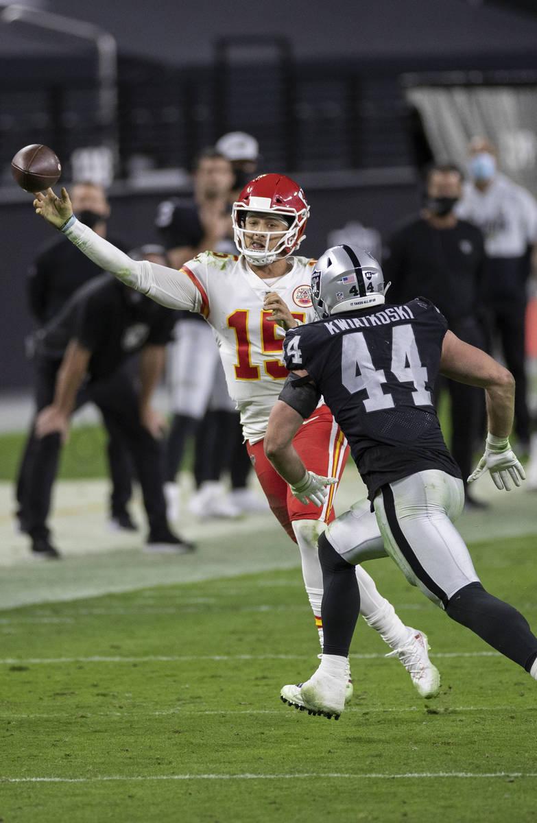 Kansas City Chiefs quarterback Patrick Mahomes (15) makes a running throw over Las Vegas Raider ...