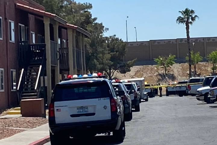 Police investigate a shooting at an east Las Vegas apartment complex on Monday, April 19, 2021. ...