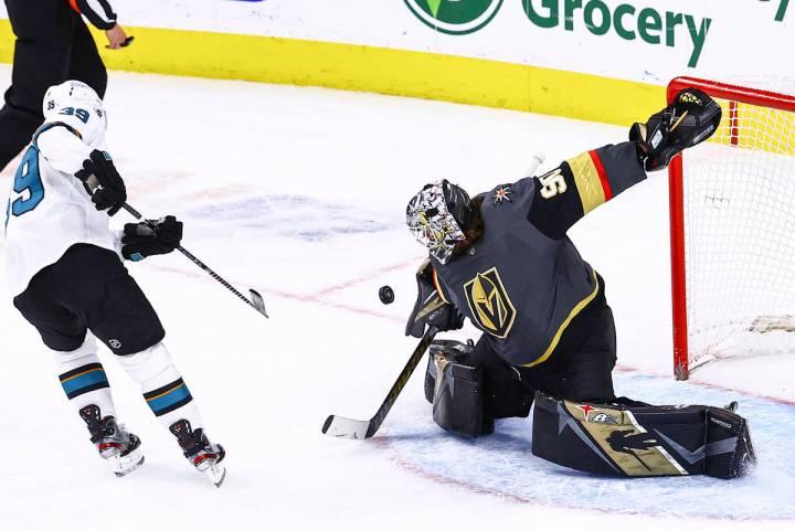 Golden Knights goaltender Robin Lehner (90) makes a save against San Jose Sharks' Logan Couture ...