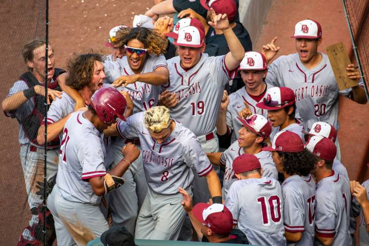 Desert Oasis teammates celebrate a run by Jacob Walsh (21) over Reno in the second inning durin ...