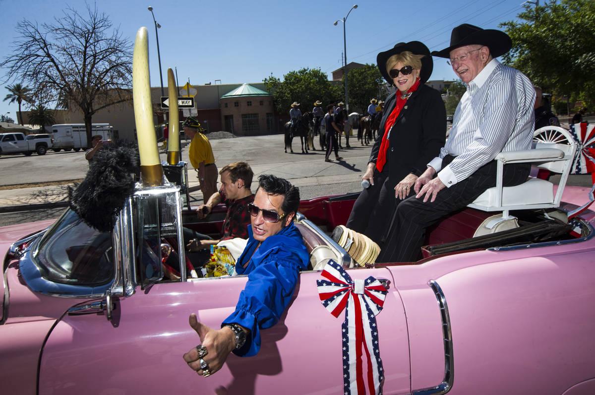Elvis impersonator Jesse Garon, left, poses with Mayor Carolyn Goodman, center, and her husband ...
