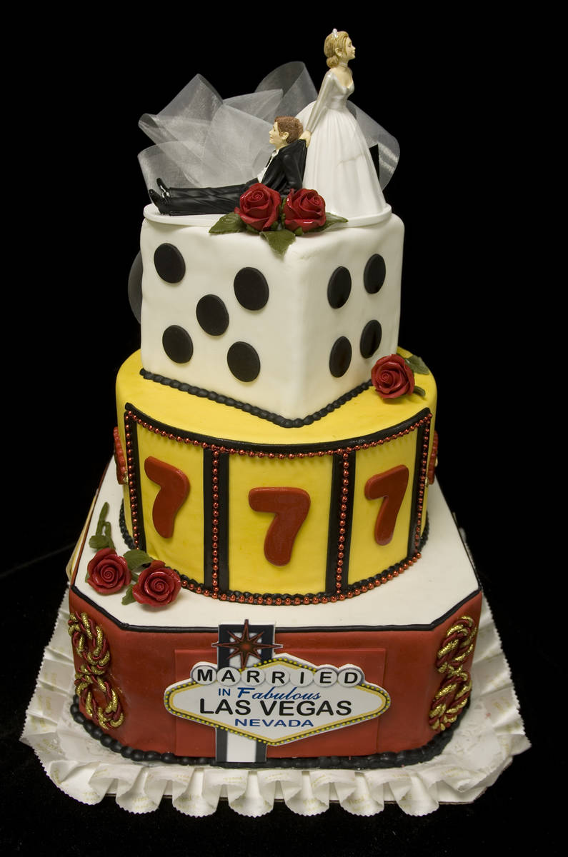 A Vegas-themed wedding cake by Freed's Bakery, which is preparing to open a dessert shop in the ...