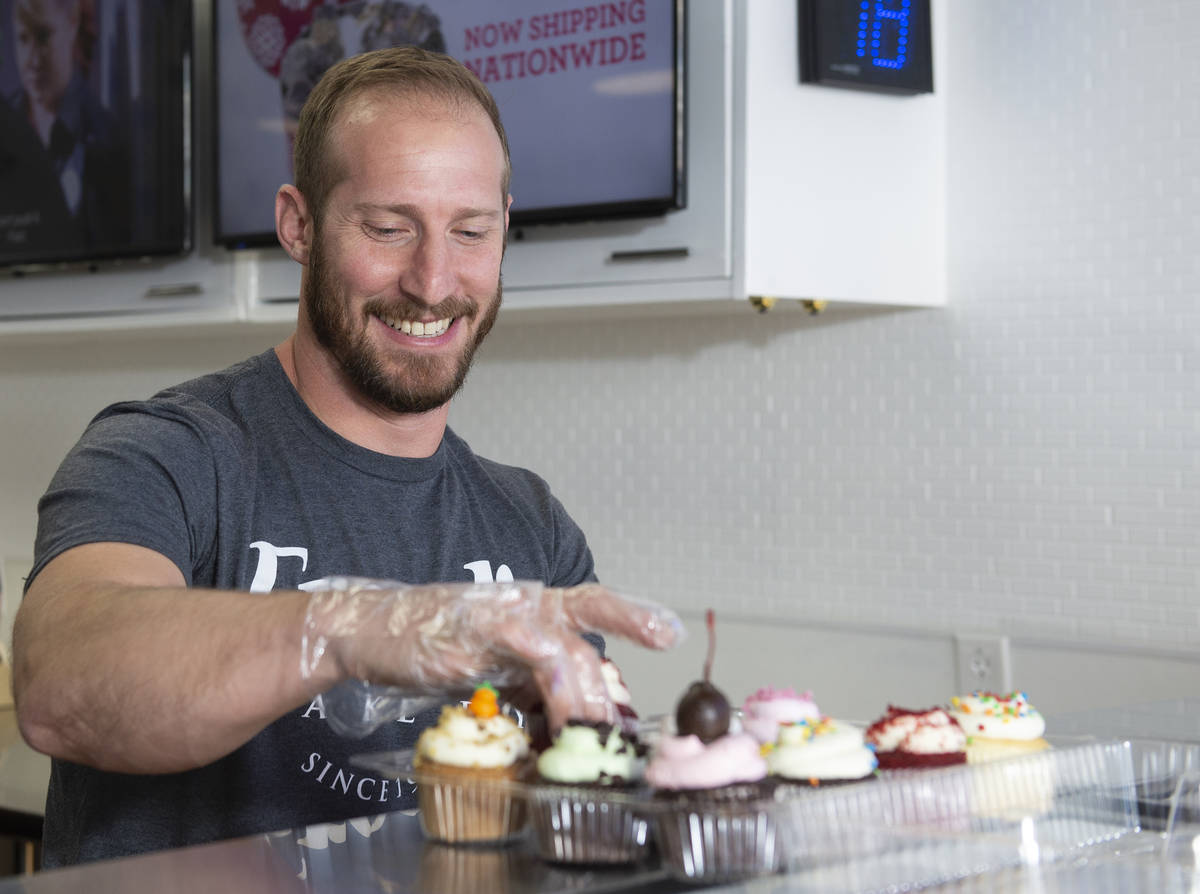 Max Jacobson-Fried, owner of Freed's Bakery, packs up some cupcakes at the Freed's dessert shop ...