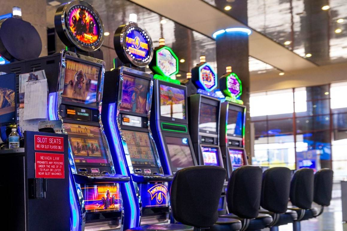 Slot machines are seen in the baggage area in Terminal 1 at McCarran International Airport in M ...