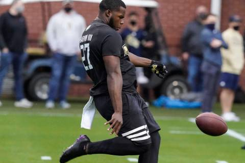 FILE - In this March 16, 2021, file photo, Georgia Tech punter Pressley Harvin III punts the ba ...