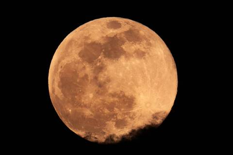 The Super Pink Moon south of the Strip above the clouds on Monday, April 26, 2021 in Las Vegas. ...