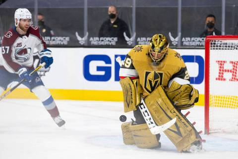 Golden Knights goaltender Marc-Andre Fleury (29) makes a save while Avalanche left wing J.T. Co ...