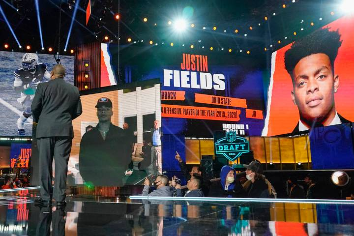 An image of Ohio State quarterback Justin Fields is displayed after he was chosen by the Chicag ...