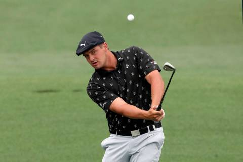 Bryson DeChambeau chips to the second hole during the third round of the Masters golf tournamen ...