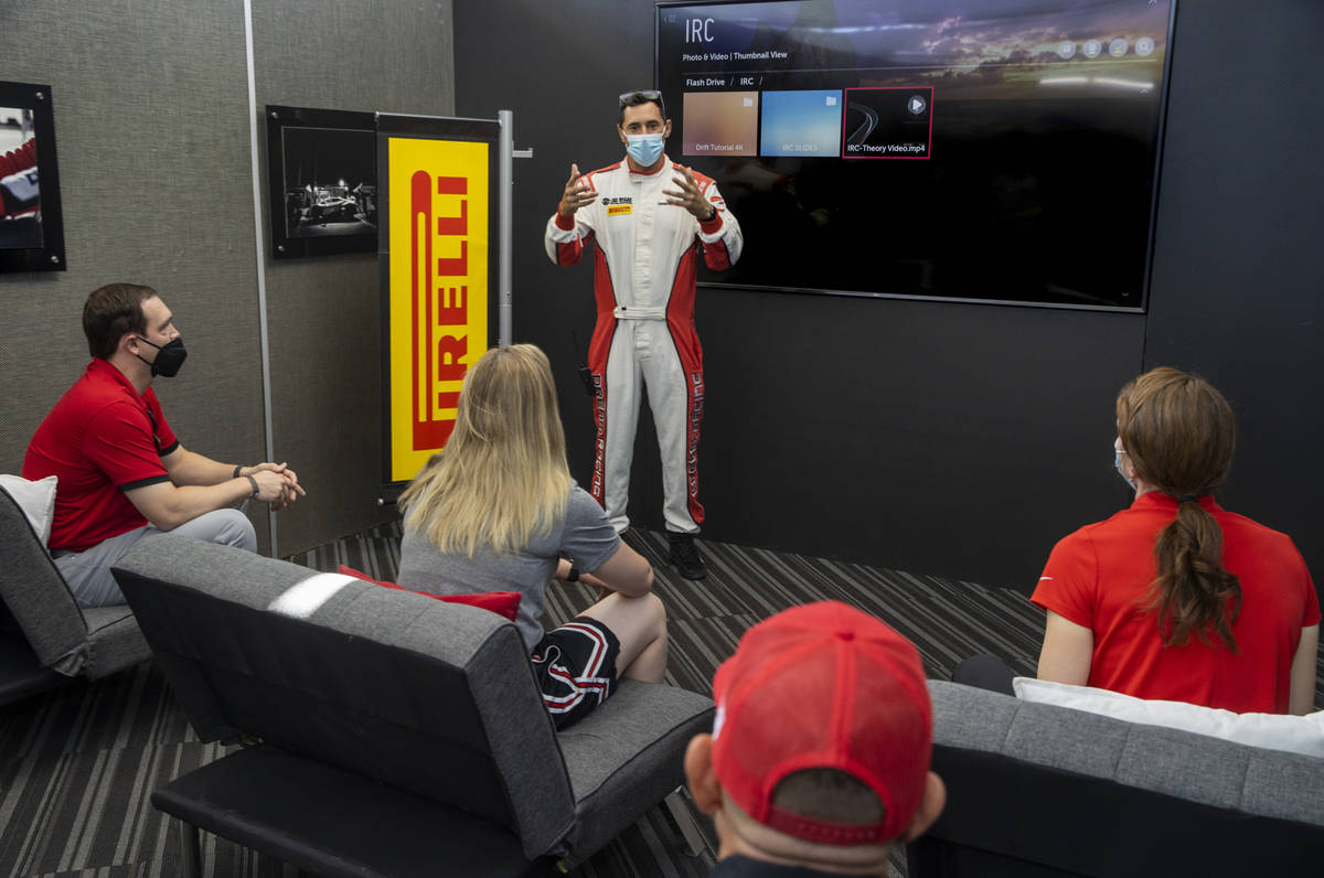Dream Racing instructor Vinny Mykulak, center, gives UNLV coaches a briefing on driving techniq ...