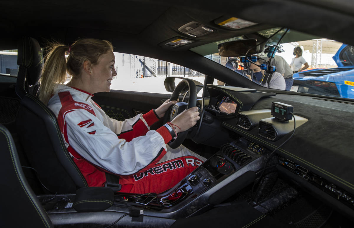 UNLV head women's basketball coach Lindy La Rocque is ready to drive as she gets behind the whe ...