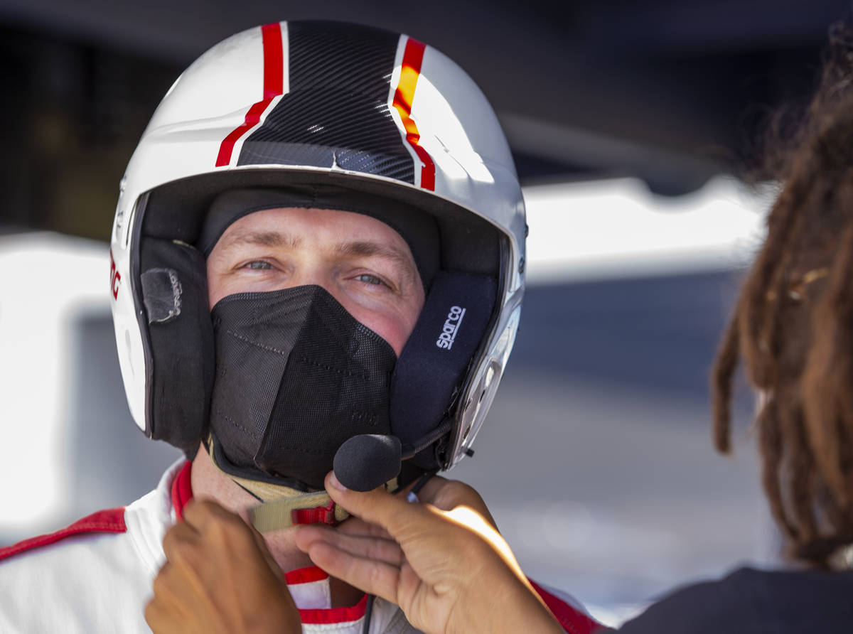 UNLV head men's basketball coach Kevin Kruger is fitted with a helmet before taking a few laps ...