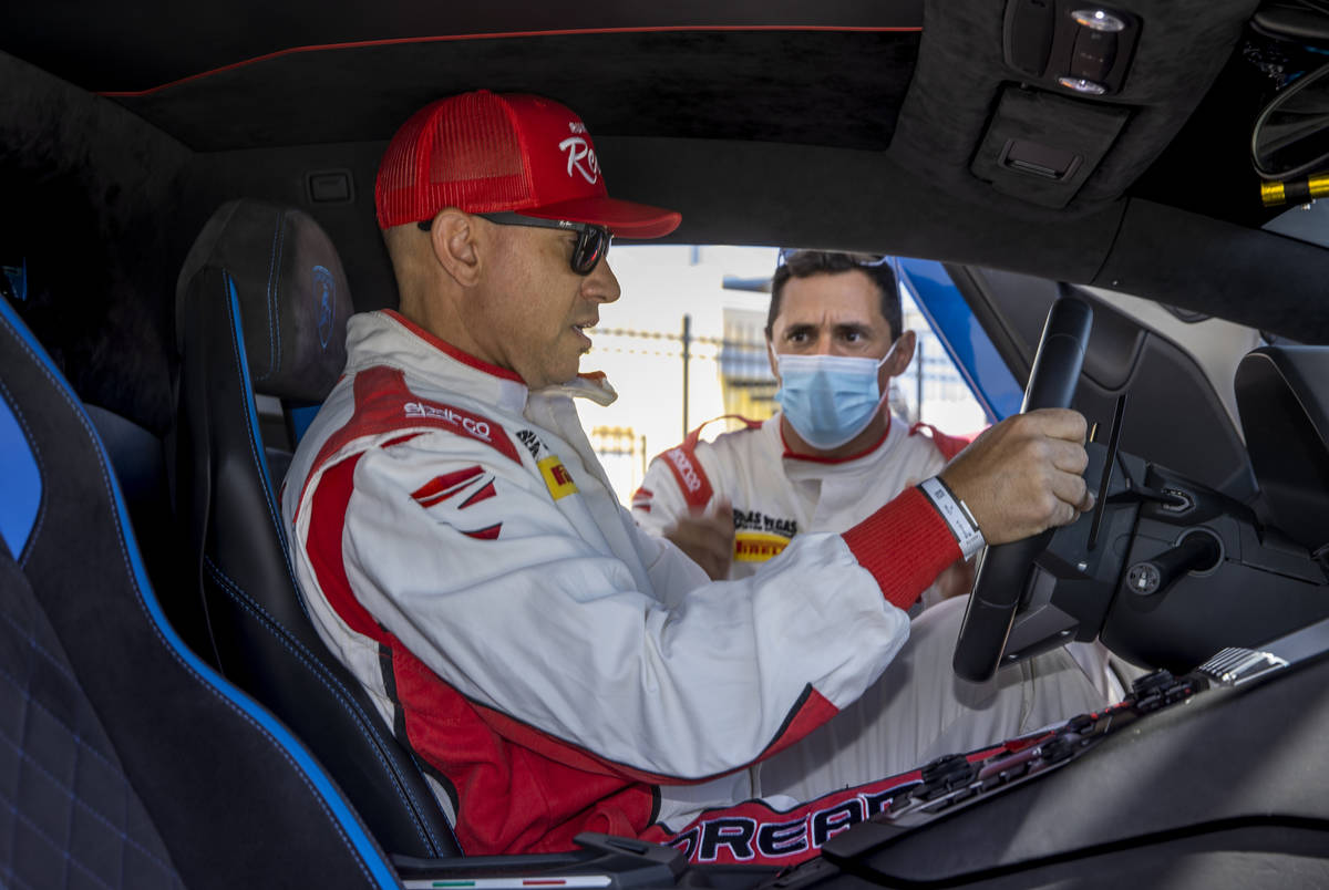 UNLV head football coach Marcus Arroyo behind the wheel with instructor Vinny Mykulak while pre ...
