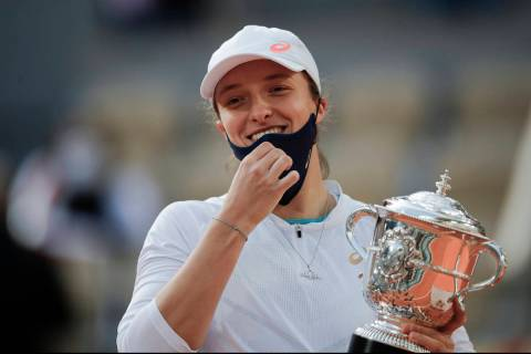 FILE - In this Saturday, Oct. 10, 2020 file photo, Poland's Iga Swiatek holds the trophy after ...