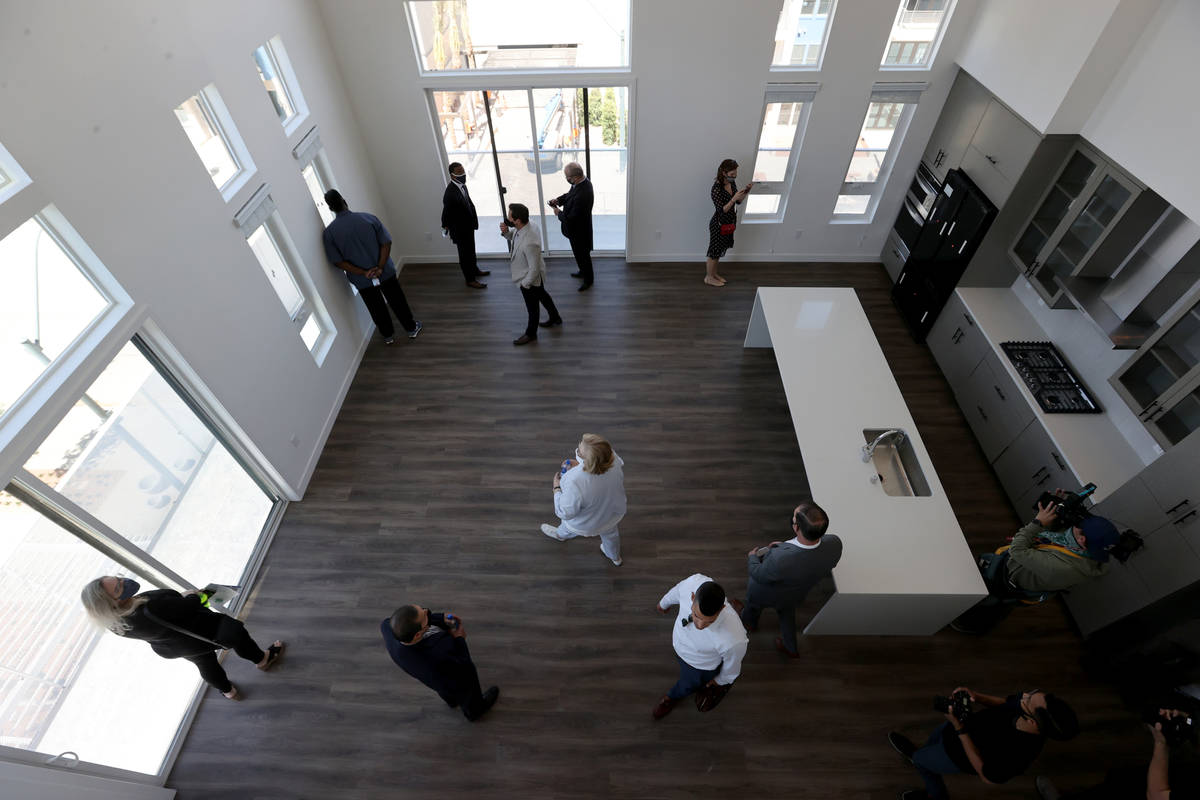 People check out a penthouse at Parc Haven apartment complex at Symphony Park in downtown Las V ...