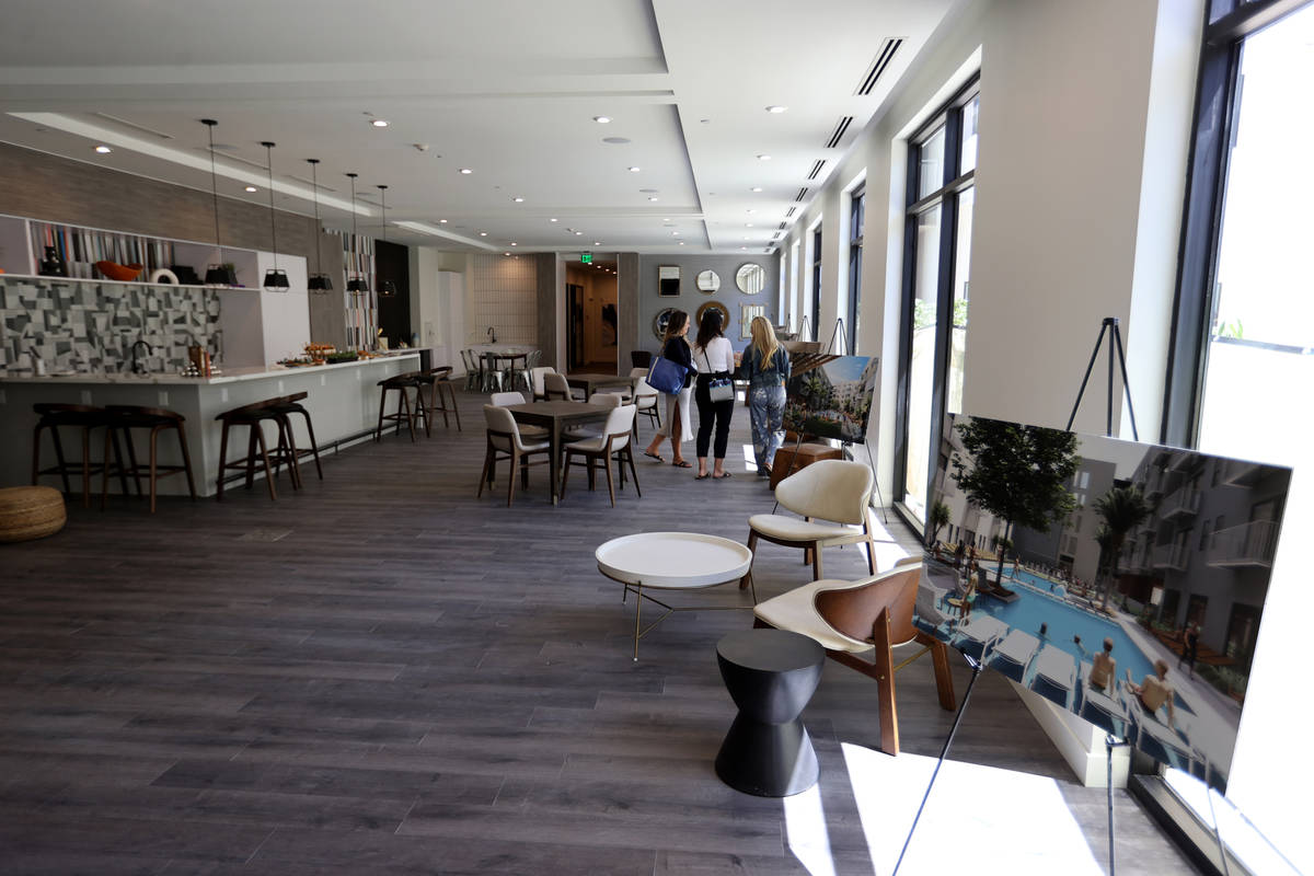 People mingle in the resident lounge at Parc Haven apartment complex at Symphony Park in downto ...