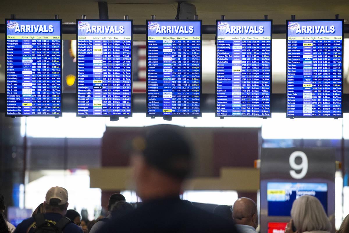 Screens show the arrivals times at McCarran International Airport Terminal 1 in Las Vegas, Thur ...