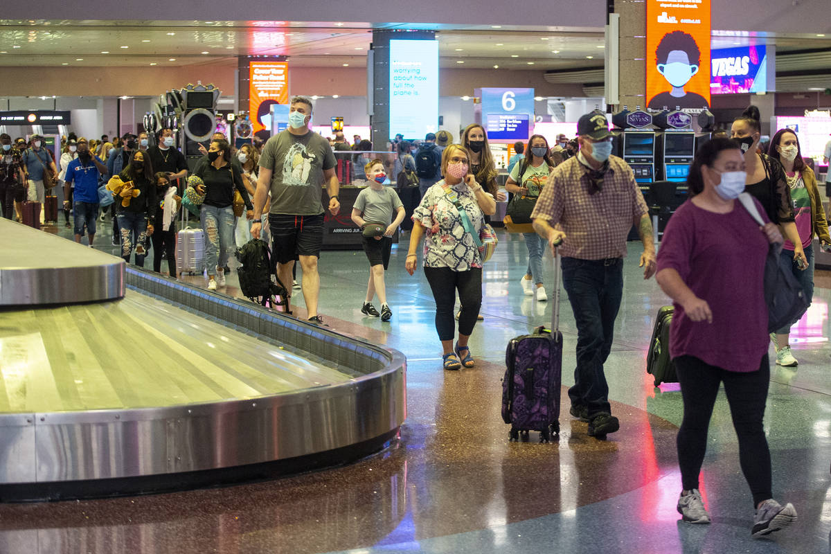 Travelers arrive to McCarran International Airport Terminal 1 in Las Vegas, Thursday, May 13, 2 ...