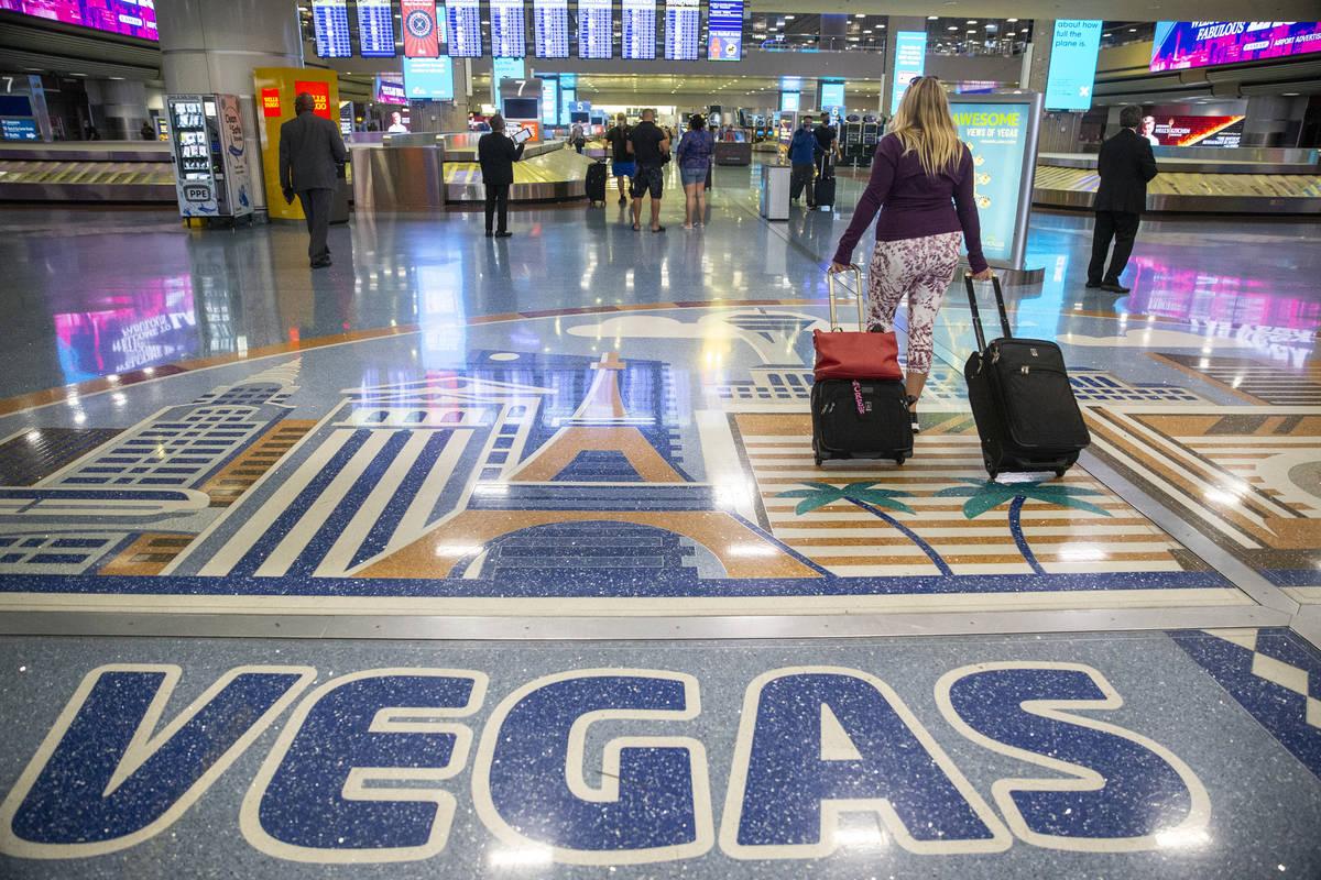 Travelers at McCarran International Airport Terminal 1 in Las Vegas, Thursday, May 13, 2021. (E ...