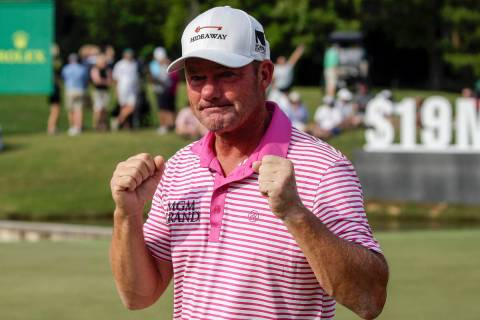 Alex Cejka, of Germany, reacts after defeating Steve Stricker on the first hole of a playoff af ...
