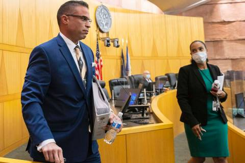 Metropolitan Police Department Detective Marc Colon leaves commission chamber after testifying ...