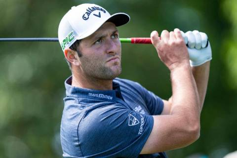 Jon Rahm watches his tee shot on the 3rd hole during the first round of the Wells Fargo Champio ...