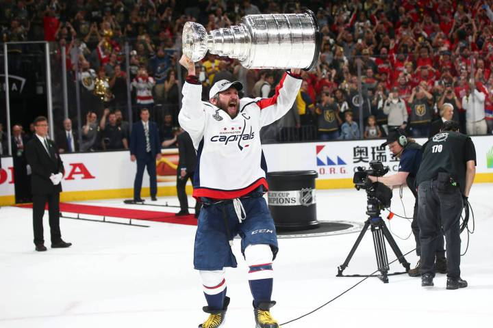 Washington Capitals left wing Alex Ovechkin (8) celebrates after defeating the Golden Knights i ...