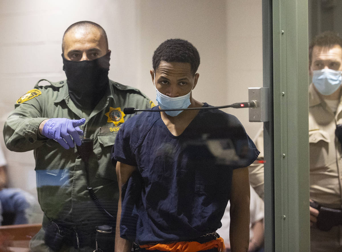 Terrell Rhodes, charged in the death of a 2-year-old boy, Amari Nicholson, is led into the cour ...