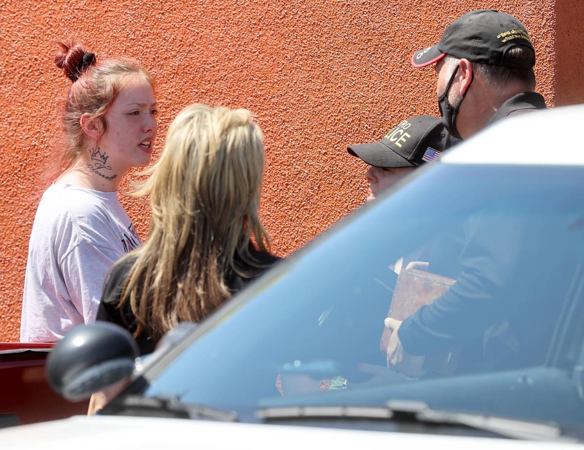 Tayler Nicholson, mother of missing Las Vegas toddler Amari Nicholson, talks to police near the ...
