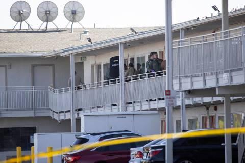 Police investigate the scene of a homicide at the Motel 6 near Koval Lane and Tropicana Avenue ...