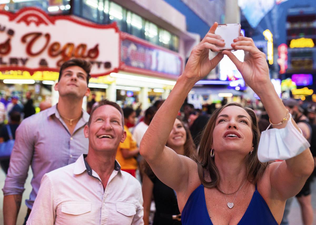 Amy Hutchinson, right, Tim Diener and Brandon Zubriski, all from Boca Raton, Fla., take photos ...