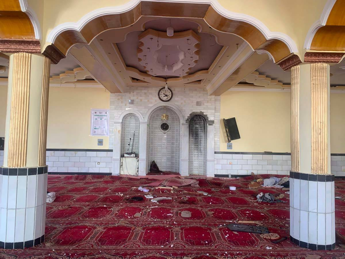 Debris covers the ground at a mosque after a bomb explosion in Shakar Dara district of Kabul, A ...